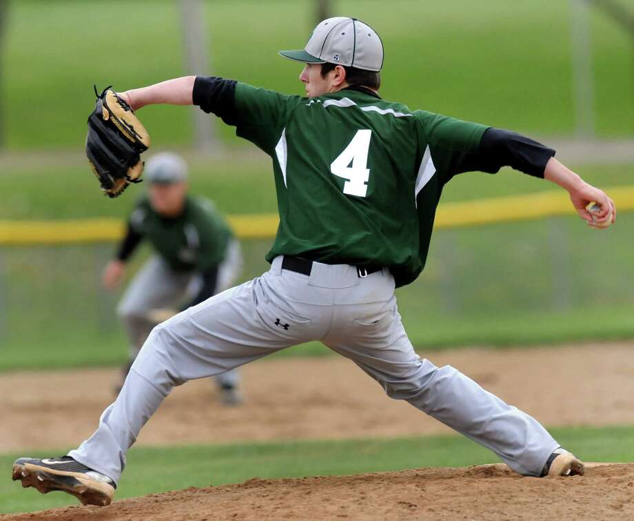 Shenendehowa's Mike Englert (4) winds up the pitch during their baseball game against Shaker on Thursday, April 26, 2012, at Shaker High in Latham, N.Y. (Cindy Schultz / Times Union) Photo: Cindy Schultz / 00017395A