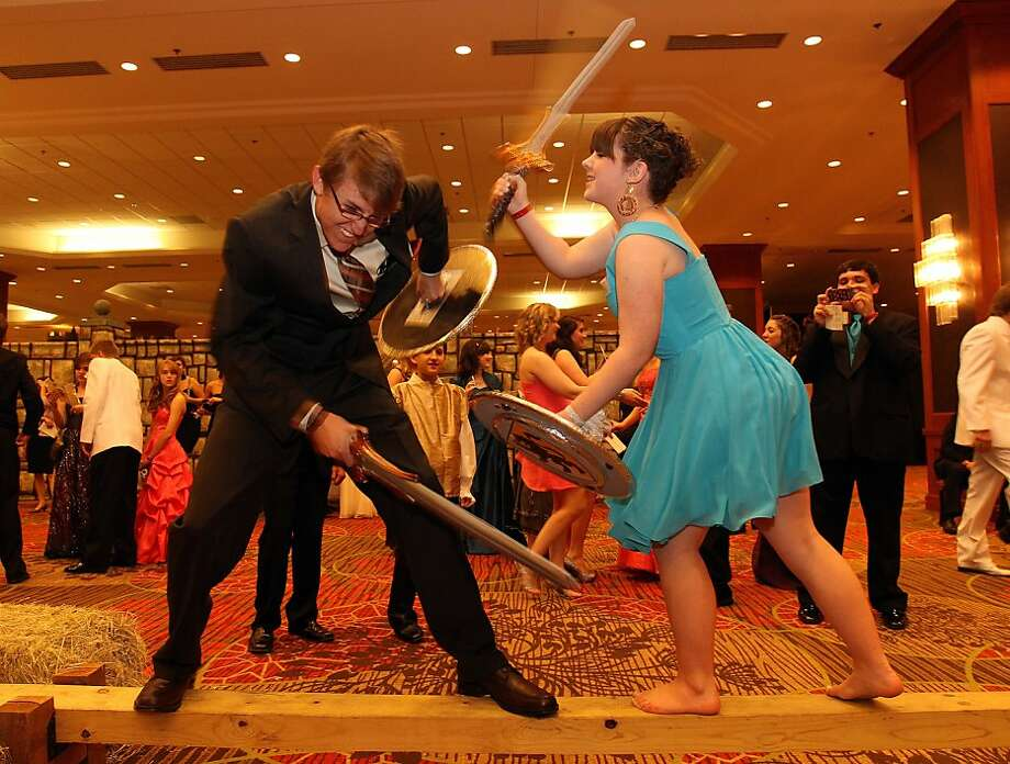 Tyler Teeter, left, and Hannah Owen participate in a mock sword battle during pre-dinner activities at the Medieval-themed Texas Christian Homeschool Prom at the Dallas Sheraton on April 21, 2012, in Dallas, Texas. (Richard W. Rodriguez/Fort Worth Star-Telegram/MCT) Photo: Richard W. Rodriguez, McClatchy-Tribune News Service