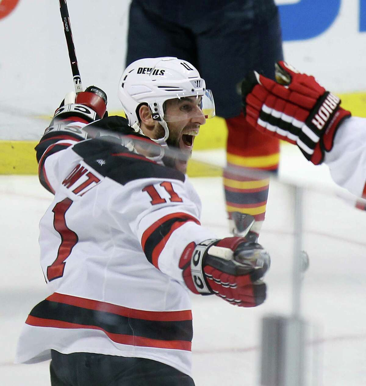 New Jersey Devils' Stephen Gionta (11) celebrates his goal during the second period of Game 7 in a first-round NHL Stanley Cup playoff hockey series in Sunrise, Fla., Wednesday, April 26, 2012, against the Florida Panthers. (AP Photo/J Pat Carter)