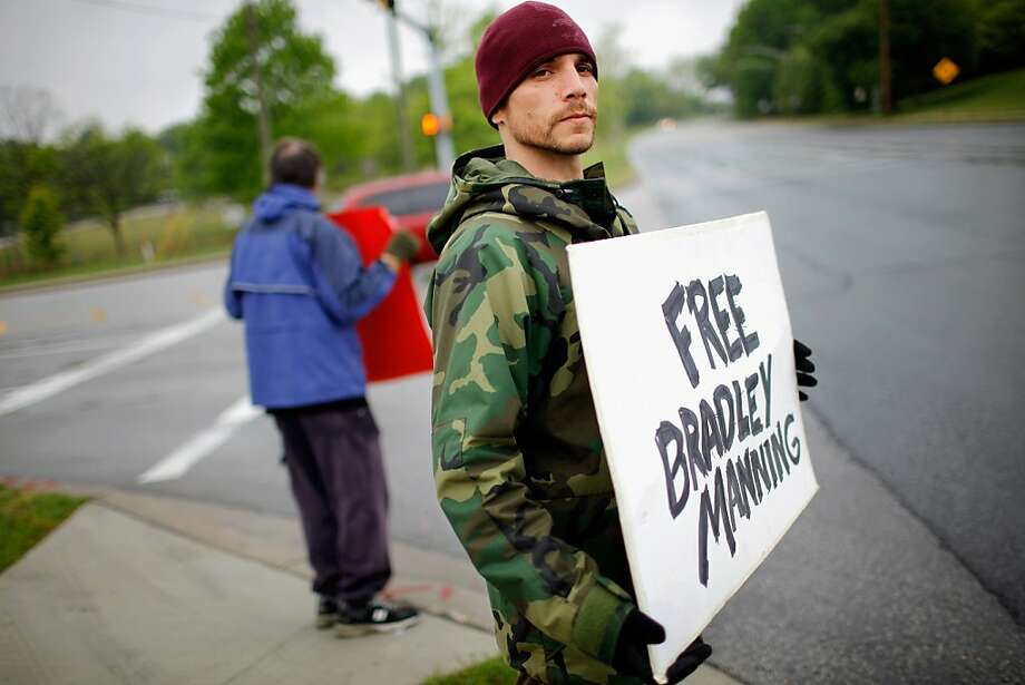 Justin Sorci of Jacksonville, Florida, shows his support for accused WikiLeaks whistle-blower U.S. Army PFC Bradley Manning while standing vigil outside the front gates of Fort George Meade April 26, 2012 in Fort Meade, Maryland. The judge in the case, U.S. Army Col. Denise Lind, is expected to rule today on a defense motion to dismiss all 22 charges against Manning, 24, who is accused of providing the Web site WikiLeaks with hundreds of thousands of sensitive documents, diplomatic cables and video clips. Photo: Chip Somodevilla, Getty Images