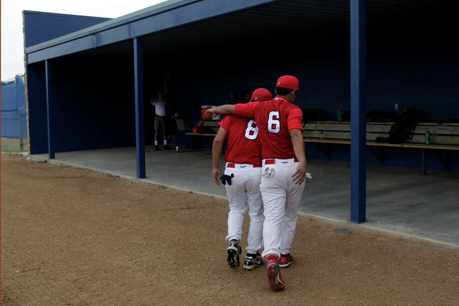 Fox Tech High School varsity baseball players Victor Oranday, left, and Carlos Rodriguez walk to their dugout during their last game as they play against Lanier at the SAISD Sports Complex in San Antonio on Thursday, April 26, 2012. Fox Tech lost, 10-0. Lisa Krantz/San Antonio Express-News Photo: Lisa Krantz, Express-News / SAN ANTONIO EXPRESS-NEWS