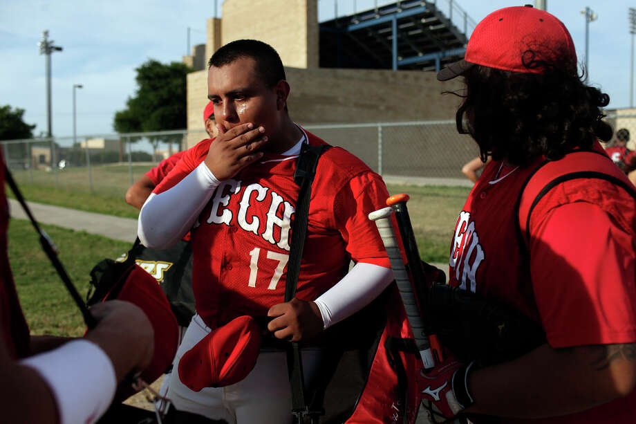 Fox Tech varsity baseball player Joe Martinez is overcome with emotion after their last game, against Lanier, at the SAISD Sports Complex in San Antonio on Thursday, April 26, 2012. Fox Tech lost, 10-0. Lisa Krantz/San Antonio Express-News Photo: Lisa Krantz, Express-News / SAN ANTONIO EXPRESS-NEWS