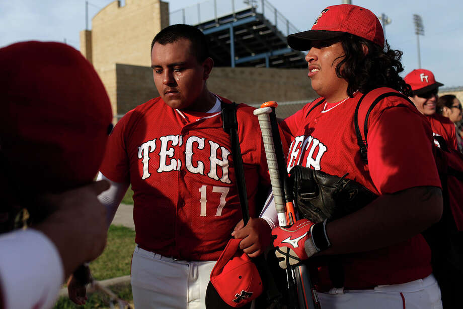 Fox Tech varsity baseball player Joe Martinez, left, is embraced by teammate Jacob Rodriguez, after their last game, against Lanier, at the SAISD Sports Complex in San Antonio on Thursday, April 26, 2012. Fox Tech lost, 10-0. Lisa Krantz/San Antonio Express-News Photo: Lisa Krantz, Express-News / SAN ANTONIO EXPRESS-NEWS