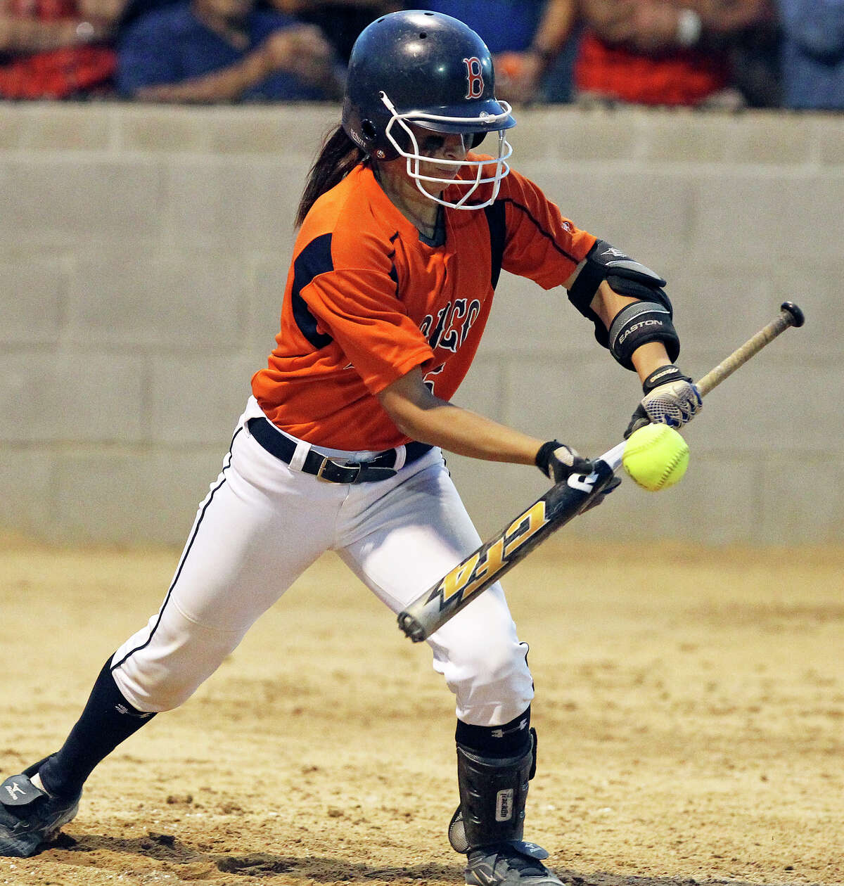 Christy Trevino lays down a bunt for the Broncos as Brandeis beats Southwest 6-4 in playoff action at Southwest High School on April 26, 2012. Tom Reel/ San Antonio EXpress-News