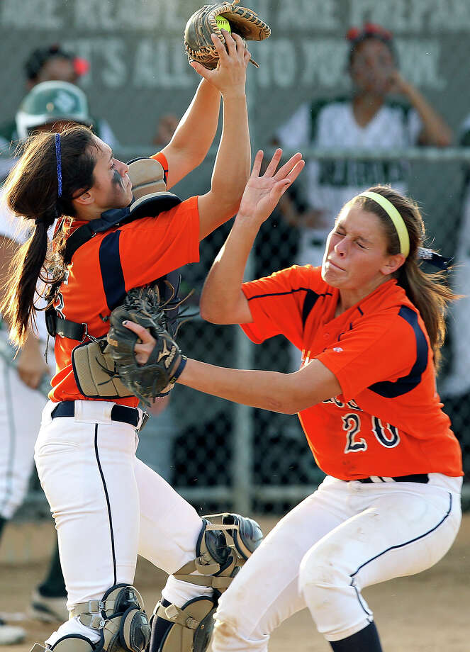 Bronco catcher Christy Trevina grabs a pop up despite her collision with third baseman Hailee Alaniz as Brandeis beats Southwest 6-4 in playoff action at Southwest High School on  April 26, 2012.  Tom Reel/ San Antonio EXpress-News Photo: TOM REEL, Express-News / San Antonio Express-News