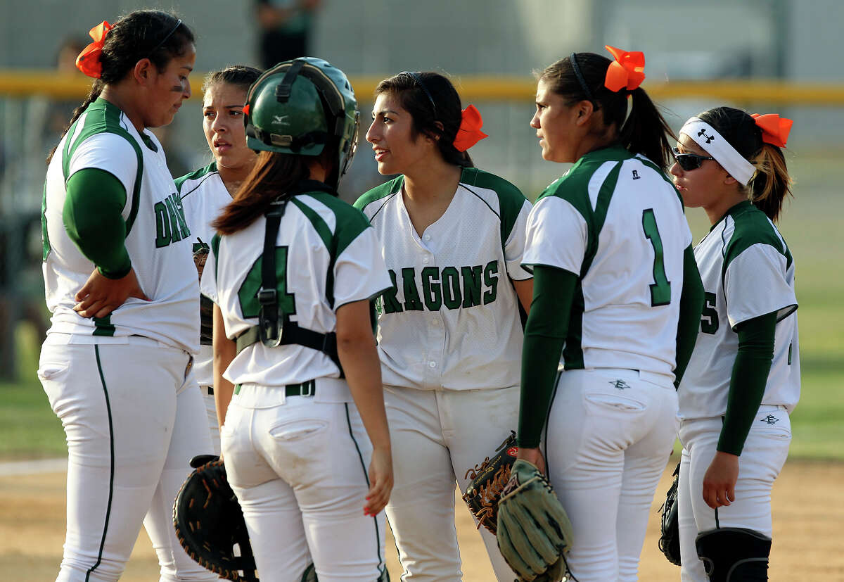 The Dragons huddle in the pitching circle after falling behind in the early going as Brandeis beats Southwest 6-4 in playoff action at Southwest High School on April 26, 2012. Tom Reel/ San Antonio EXpress-News