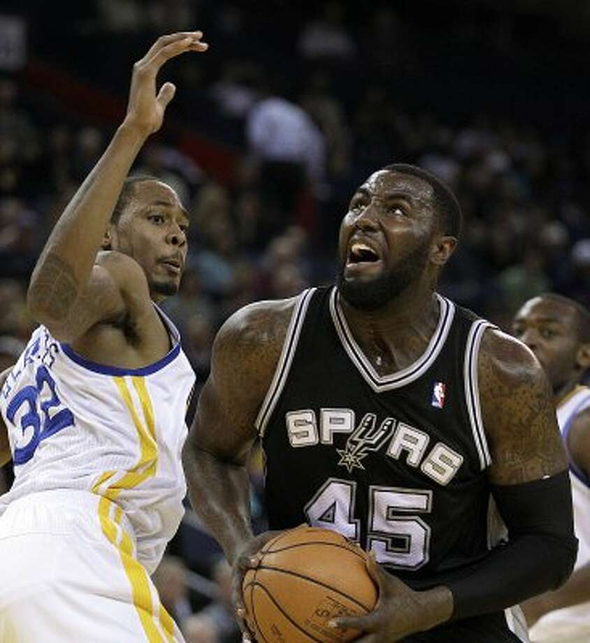 San Antonio Spurs' DeJuan Blair, right, looks to shoot against Golden State Warriors' Mickell Gladness during the first half of an NBA basketball game, Thursday, April 26, 2012, in Oakland, Calif. (AP Photo/Ben Margot) (AP)