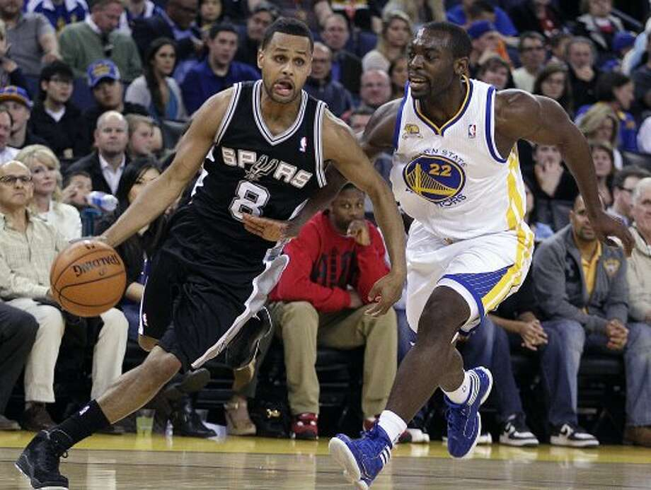 San Antonio Spurs' Patty Mills, left, drives the ball against Golden State Warriors' Charles Jenkins during the first half of an NBA basketball game, Thursday, April 26, 2012, in Oakland, Calif. (AP Photo/Ben Margot) (AP)