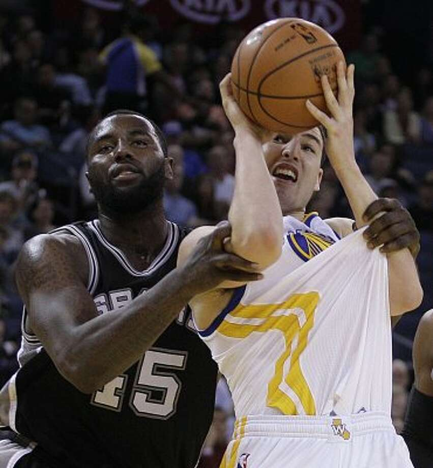 San Antonio Spurs' DeJuan Blair, left, fouls Golden State Warriors' Klay Thompson during the second half of an NBA basketball game Thursday, April 26, 2012, in Oakland, Calif. (AP Photo/Ben Margot) (AP)