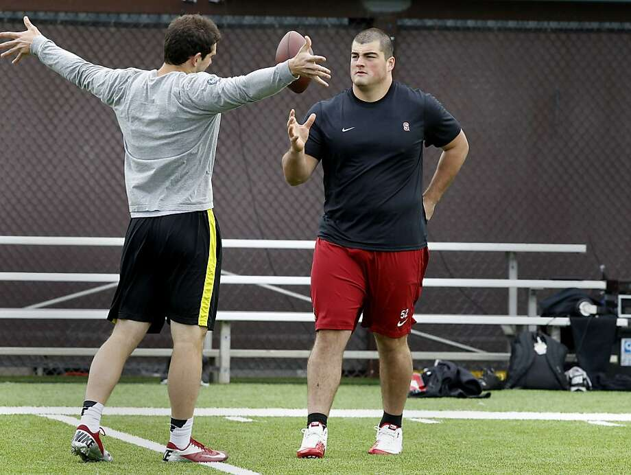 Andrew Luck (left) and David DeCastro talked during the workout. Stanford football players worked out for pro scouts at the university Thursday March 22, 2012. Photo: Brant Ward, The Chronicle