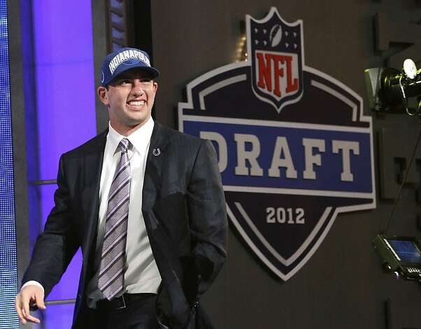 Stanford quarterback Andrew Luck walks on stage after he was selected as the first pick overall by the Indianapolis Colts in the first round of the NFL football draft at Radio City Music Hall, Thursday, April 26, 2012, in New York. Photo: Mary Altaffer, Associated Press