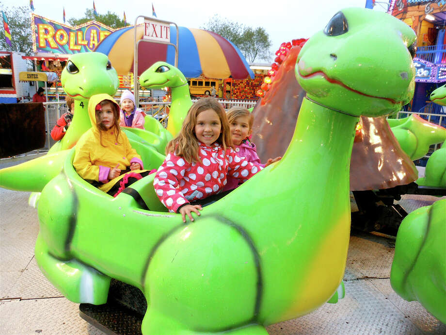 Athena Chrysadakis, 3, with Natalia and Mariella Graceffa on the Dinosaur ride Thursday night at McKinley School PTA carnival on Jennings Beach. Photo: Mike Lauterborn / Fairfield Citizen contributed