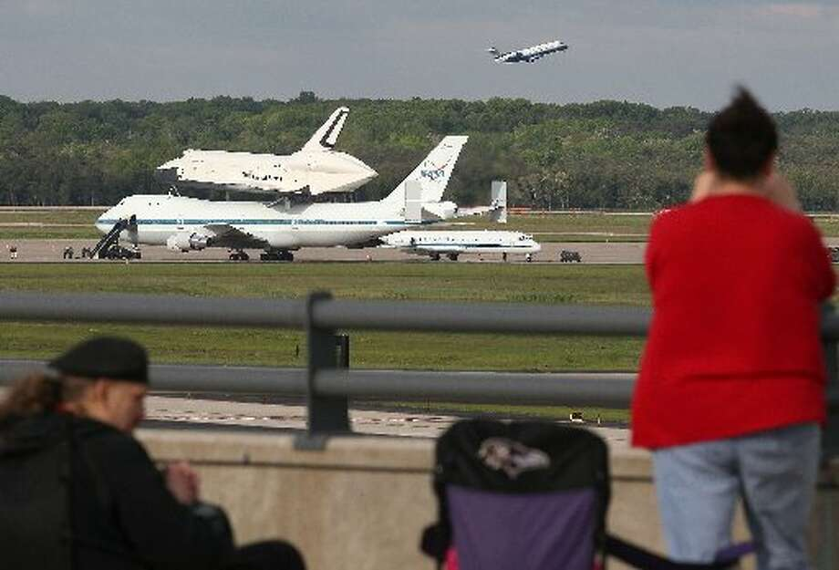 The space shuttle Enterprise sits atop a NASA 747 shuttle carrier aircraft before departing Washington Dulles International Airport, on April 27, 2012 in Dulles, Virginia. Later this morning Enterprise will be ferried to John F. Kennedy International Airport in New York to go on display at New York City's Intrepid Sea, Air and Space Museum. (Photo by Mark Wilson/Getty Images)
