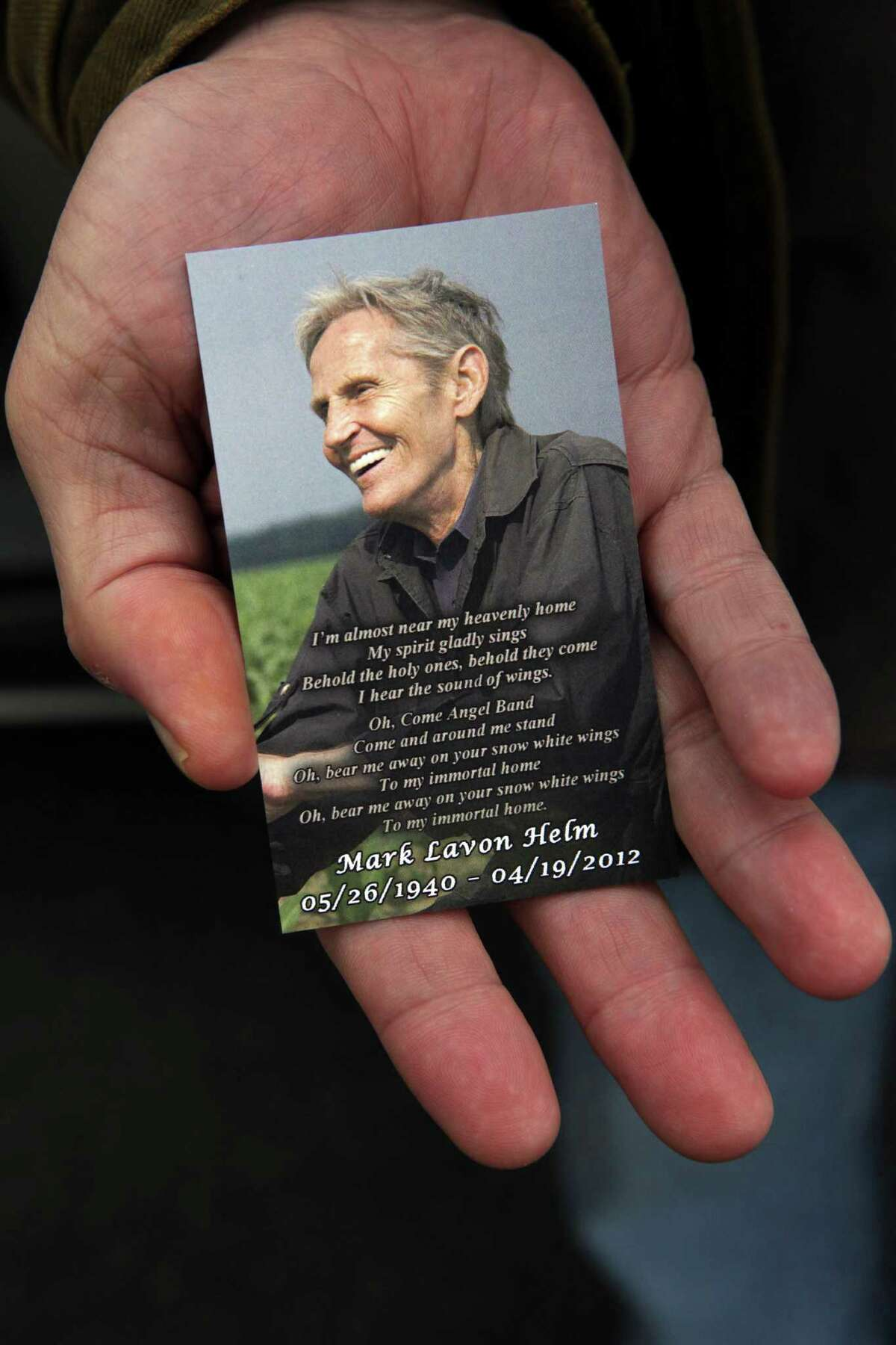 A card memorializing the late Levon Helm that was handed out at his wake in Woodstock, N.Y., April 26, 2012. Friends and fans came out in the thousands to attend the public wake of the artist, who died last week at the age of 71. (Suzanne DeChillo/The New York Times)