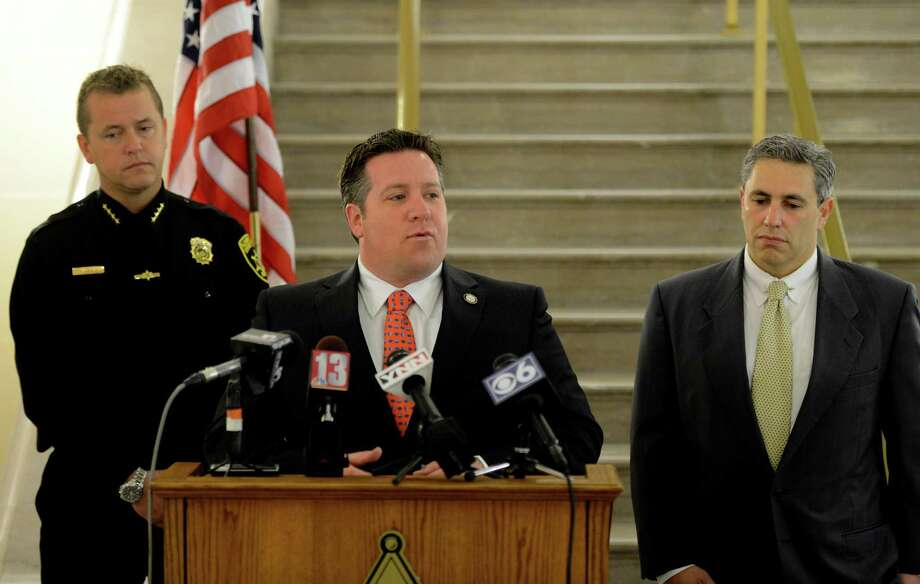 "Albany County Executive Dan McCoy announced the results of a sting operation held yesterday afternoon at a local ""Cash For Gold"" store in Albany, N.Y during a press conference held at the Albany County Courthouse April 27, 2012. McCoy is joined by Albany County Sheriff Craig Apple, left and Albany County Attorney Thomas Marcelle, right. (Skip Dickstein / Times Union archive) Photo: SKIP DICKSTEIN / 2012"