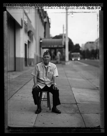Mitsunobu ÒMitsÓ Kojimoto, 85, sits in outside the building on Van Ness Street in San Francisco July 11, 2008 where he waited for a bus to take him to the SantaAnita Assembly Center. At age 19, Kojimoto volunteered for the U.S. Army and joined the 442nd Regimental Combat Team, H company. He received the Bronze Star for his service in France and Italy. Photo: Paul Kitagaki Jr.