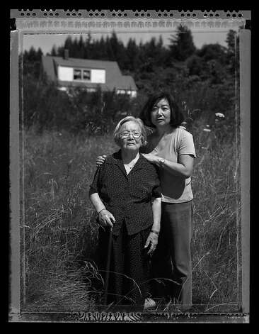 Fumiko Hayashida, 95, and her daughter Natalie Ong, 66, photographed July 20, 2006 on the family farm where they were evacuated from on Bainbridge Island, Waashington.  Fumiko Hayashida, a young mother of thirty-one, carries her 13 month-old daughter Natalie Kayo, holding her teddy bear, on March 30, 1942, walking at the Eagledale Ferry landing surrounded by armed soldiers to a waiting ferry on Bainbridge Island that would send her to Manzanar Internment Camp in California arriving by train on April 1, 1942. Photo: Paul Kitagaki Jr.