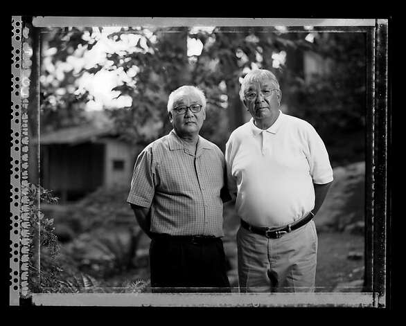 "Bill Asano, 70, right, and his brother, Jerry Aso, 67,  photographed in Portland, Oregon September 1, 2006 are both dental professionals. On May 5, 1942 they were photographed with their 70 year old grandfather Sakutaro Aso, who started the Mt. Eden Laundry in Hayward, California and sold the business before going to the Tanforan Assembly Center, Topaz and Amache Internment Camps during WWII. Bill said,""  when I look at the picture I can see my grandfather realized that something terrible was happening and his life was never going to be the same again, that was the end of the line for him.""  Jerry said looking at the photograph of his grandfather, "" So his dream of coming to the United States, his dream of making a life, his dream of having his children working in this business, to support them all were totally dashed."" Photo: Paul Kitagaki Jr."