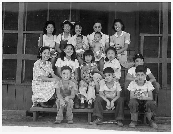 Evacuee orphans of Japanese ancestry were photographed by Dortohea Lange on July 1, 1942 at the Children's Village at the War Relocation Authority Center at Manzanar.  Mrs. Harry Matsumoto, bottom left,  a University of California graduate, and her husband are superintendents of the Children's Village where 65 evacuee orphans from three institutions are now housed. Photo: Dorothea Lange, National Archives