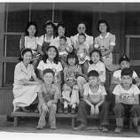 Evacuee orphans of Japanese ancestry were photographed by Dortohea Lange on July 1, 1942 at the Children's Village at the War Relocation Authority Center at Manzanar.  Mrs. Harry Matsumoto, bottom left,  a University of California graduate, and her husband are superintendents of the Children's Village where 65 evacuee orphans from three institutions are now housed.