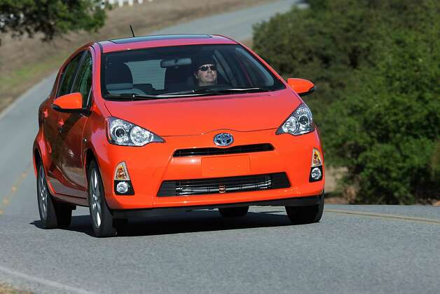 "The ""C"" in the 2012 Toyota Prius C stands for ""city,"" and as one would expect of a Prius designed for city use, it's smaller of size and price than the original Prius liftback. (MCT) Photo: Handout, McClatchy-Tribune News Service"