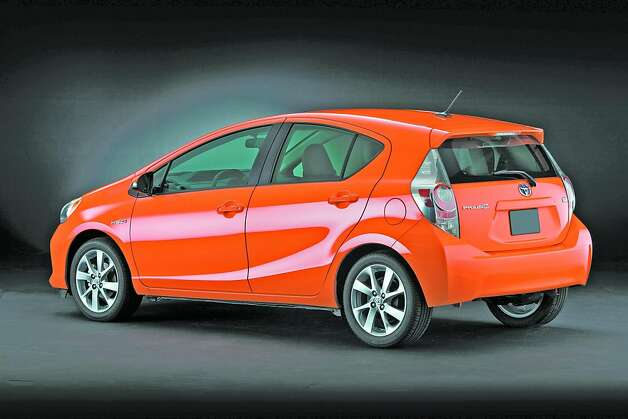 The entire Prius c lineup displays a sleek, youthful and sporty image, with its aerodynamic form, athletic stance and smaller footprint. Wheel-wells are pronounced, with the front and rear wells connected by a gently rising character line. The rear is finished off by tall taillamp units, an integrated roof spoiler and smooth, wide fascia. Photo: Toyota