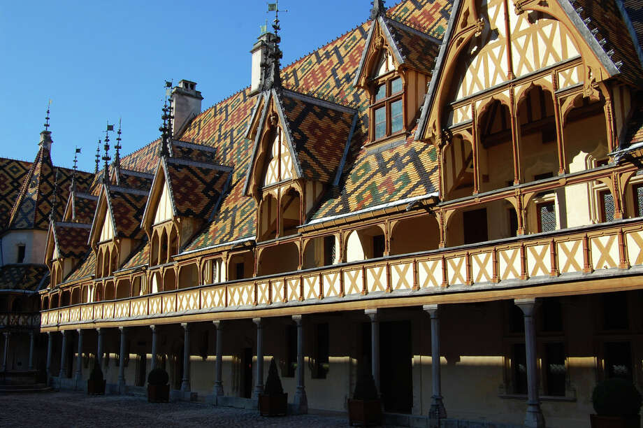 The geometrically patterned tiles decorating the steep roofs of the Hospice de Beaune are an art form in themselves. Photo: Rick Steves, Ricksteves.com