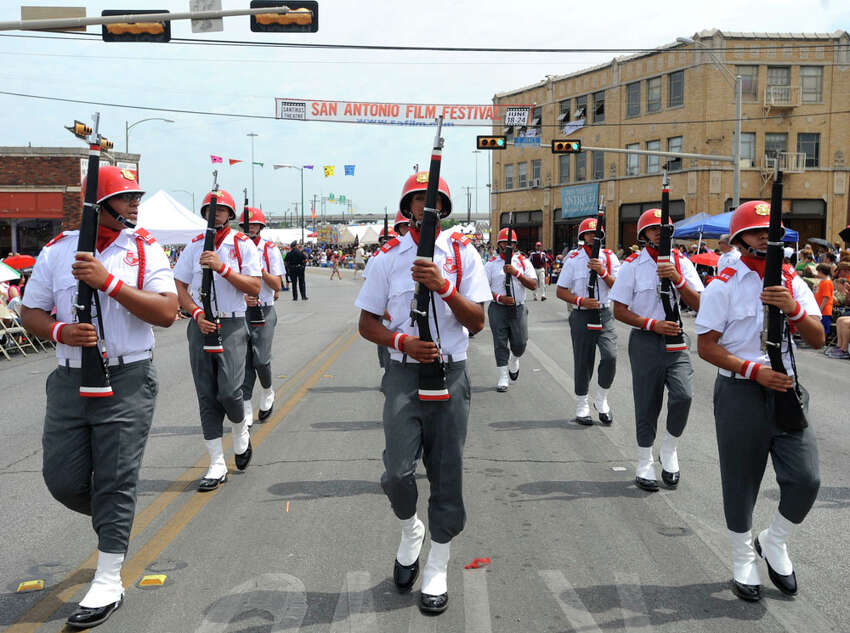 The Lee High School JROTC drill team marches along Broadway during the Vanguard portion of the Battle of Flowers Parade on April 27, 2012.