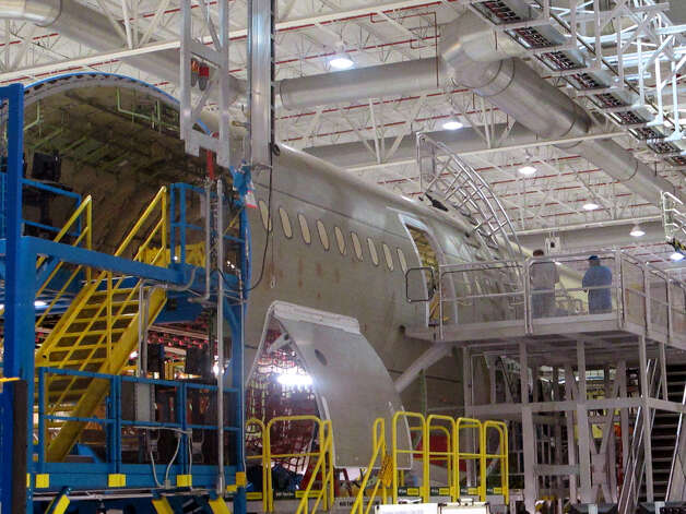 Workers assemble the middle section of Boeing's new 787 aircraft at the company's plant in North Charleston, S.C., on Friday, April 27, 2012. Photo: AP