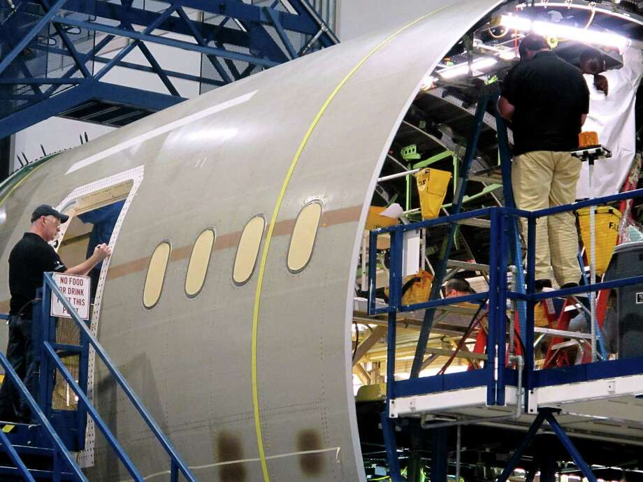 Workers assemble the aft section of Boeing's new 787 aircraft at the company's plant in North Charleston, S.C., on Friday, April 27, 2012. Photo: AP