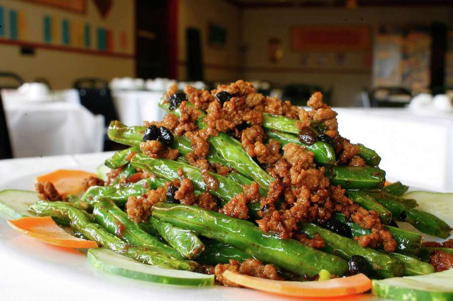 "Sautéed string beans at Mala Sichuan, a Chinese/ Szechuan restaurant on 9348 Bellaire Blvd. ""Since my first meal there back in the fall, I've suffered fierce pangs of longing for those fabulous cold noodles and for a clutch of other dishes that really turned my head."" Alison Cook Photo: Steve Ueckert / Houston Chronicle"