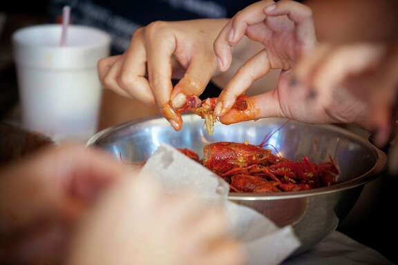 Guests tear into crawfish at Crawfish and Noodles.