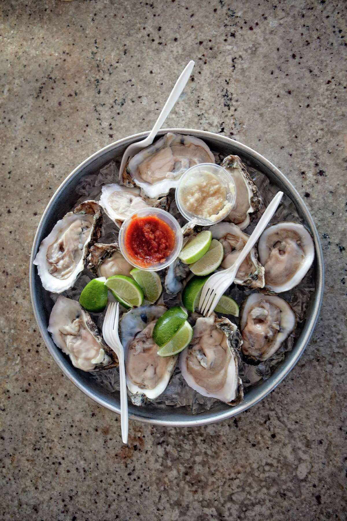 A tray of raw oysters at Crawfish & Noodles