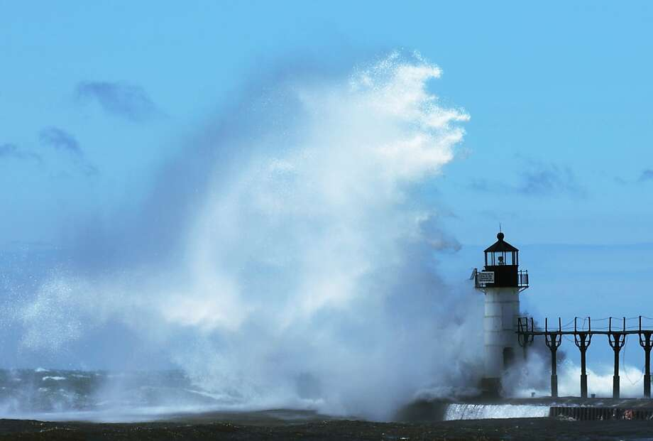 The lake was angry that day, my friends: St. Joseph North Pier Outer Lighthouse in St. Joseph, Mich., is probably not taking visitors at the moment. Photo: Don Campbell, Associated Press