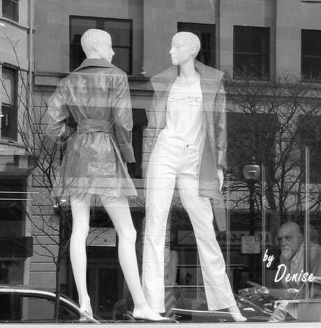 "Lee Paine captured this shot of a store window in Boston. ""I could see a man who appeared to looking very hard, even disapprovingly, at the mannequins' legs . . . "" Paine says. ""It's such a city scene!"" Photo: Contributed Photo"