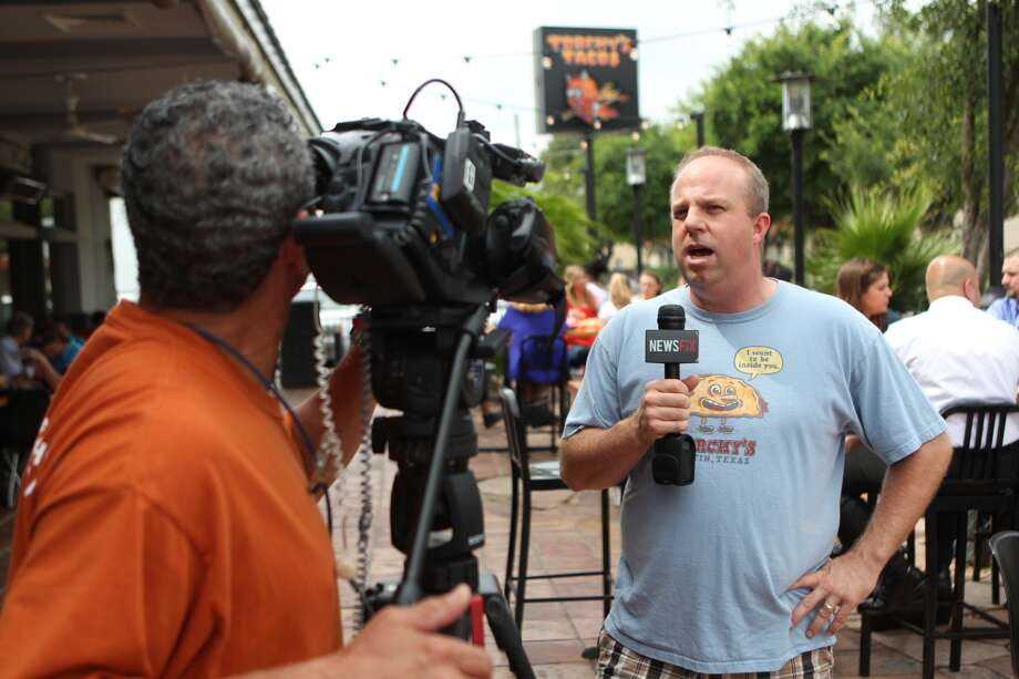 Torchy's Tacos owner and founder Michael Rypka is interviewed by a television news crew. After a largely unfavorable review of the taqueria in 29/95, owner Rypka gave away free tacos on Friday from 11 a.m. to 2 p.m. to anyone who showed up with a copy of the review. A large number of people showed up. As did members of the media. Photo: Johnny Hanson, Houston Chronicle