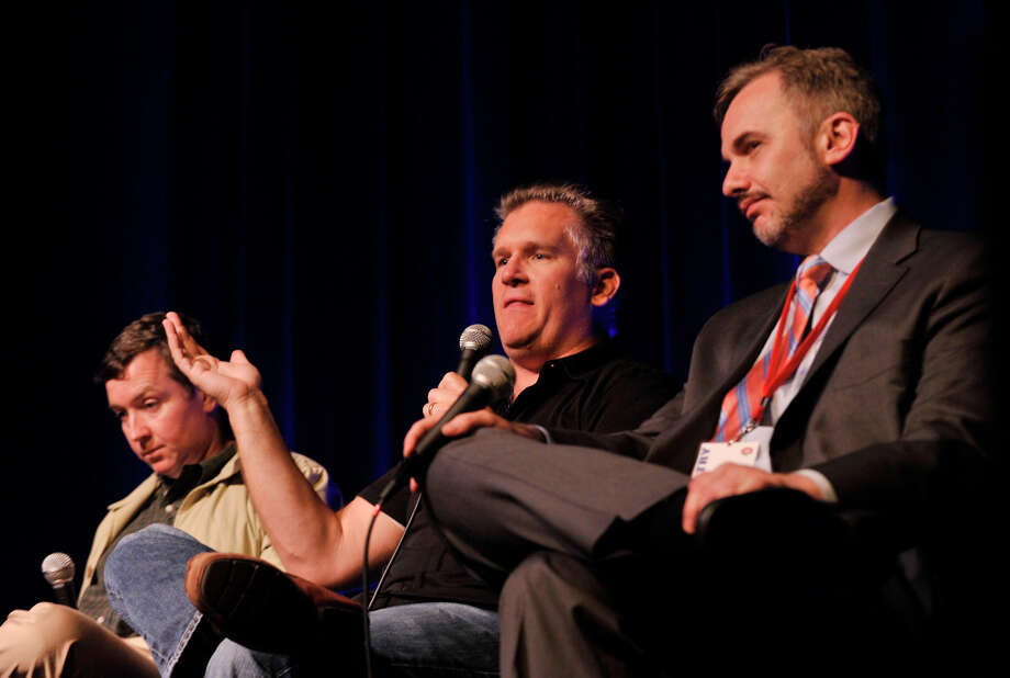 "From left, Roddy Boyd, Nick Verbitsky and Eric Kolchinsky answer questions about the Wall Street meltdown during a panel discussion after the showing of ""Confidence Game"" at the Connecticut Film Festival at the Palace Theatre in Danbury, Conn., on Thursday, April 26, 2012. Photo: Jason Rearick / The News-Times"