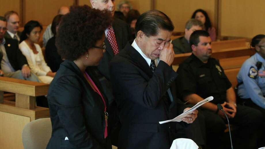Renato Raymundo, father of Anna Lisa Raymundo, breaks down as he reads a victims statement during the sentencing of Sheila Davalloo at state Superior Court in Stamford April 27, 2012. Davalloo was convicted for the murder of Anna Lisa and was sentenced to serve 50 years by Judge Richard Comerford. ( Matthew Brown/The Journal News ) Photo: Matthew Brown/The Journal News / The Journal News