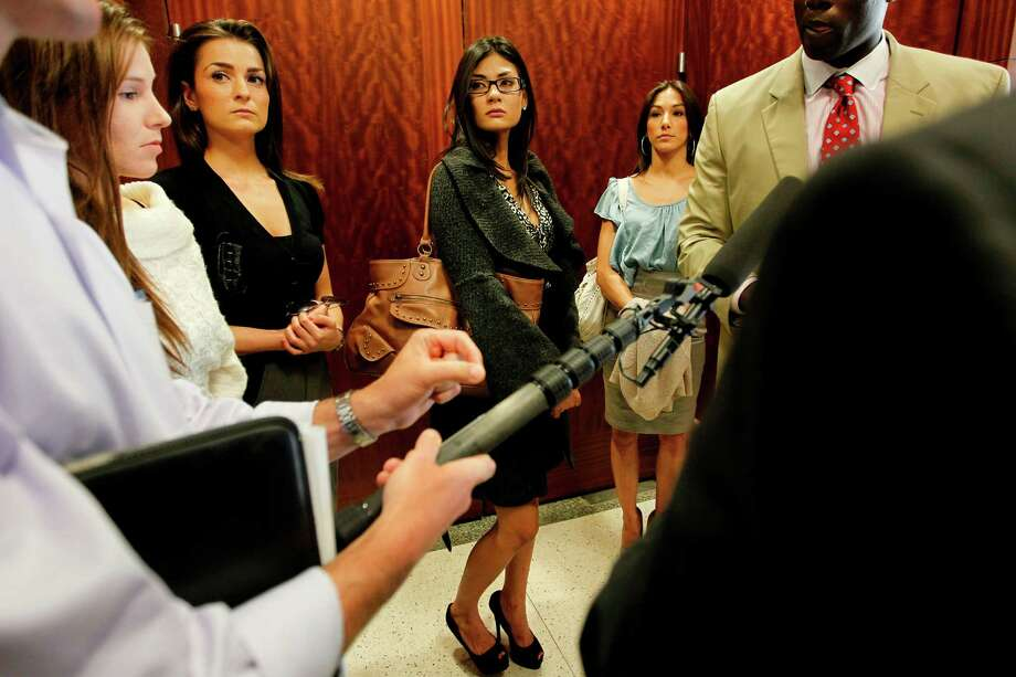 "Exotic dancers Allison Kelly, Kara Laughead, Teresa Weeks, Amber Wilson listen to defense attorney Wilvin J. Carter address the media after Judge Sherman Ross denies Germaine ""Jell-O"" Wallace bail and sanctuary during a hearing at The Harris County Criminal Justice Center on Friday, April 27, 2012, in Houston. Photo: Mayra Beltran, Houston Chronicle / © 2012 Houston Chronicle"