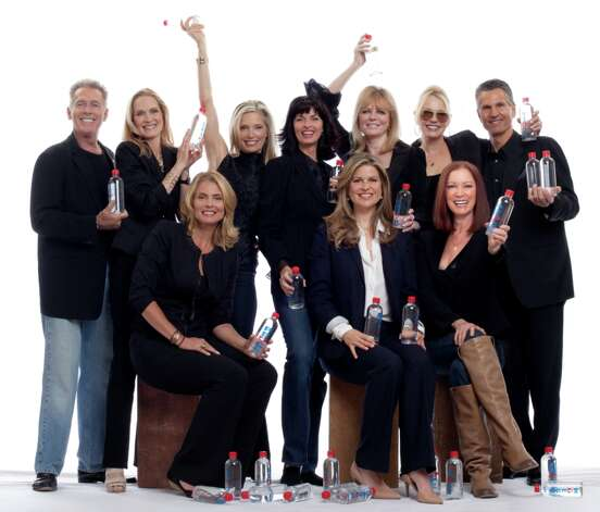 Supermodels who support Elena Davis' I Am Waters campaign to provide bottled water to the homeless include (from left, back row) Jack Scalia, Diane deWitt, Kelly Emberg, Joan Severance, Cheryl Tiegs, Kim Charlton and Tony Spinelli; and (front row, from left) Kim Alexis, Davis and Tara Shannon. Photo: Courtesy, Elena Davis