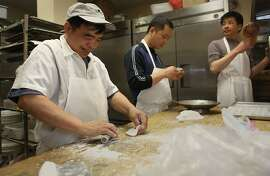 Head dim sum chef Chan Wai Ming (left), watches as dim sum chef Guo Cai Zhu (middle) shapes dough at All Seasons Restaurant in Diamond Heights in San Francisco, Calif.,  on Thursday, April 19, 2012.  At far right is dim sum chef Tiliang Rong.