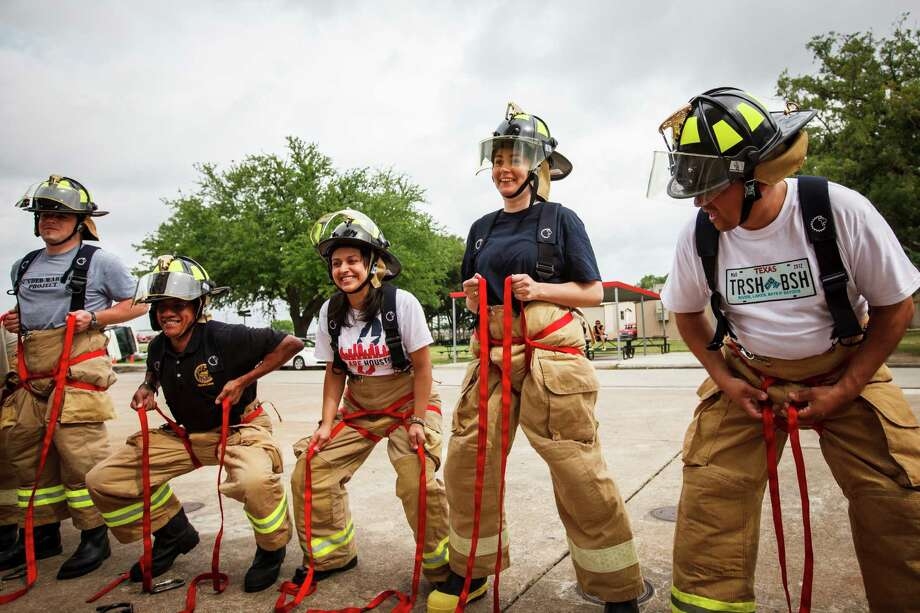"Jonathan Newport, Chief of Staff for Councilman Jack Christie, (left to right), William Paul Thomas, Houston City Council Liaison, Jessica Michan, Press Secretary, Helena Brown, Houston City Council Member, and Ed Gonzalez, Houston City Council Member, tighten their harnesses during a rappelling exercise with fellow Council Members and City Council staff at the one-day fire department orientation course called ""Fire Ops 101"" at the Houston Fire Department Val Jahnke Training Academy, Friday, April 27, 2012, in Houston. Photo: Michael Paulsen, Houston Chronicle / © 2012 Houston Chronicle"