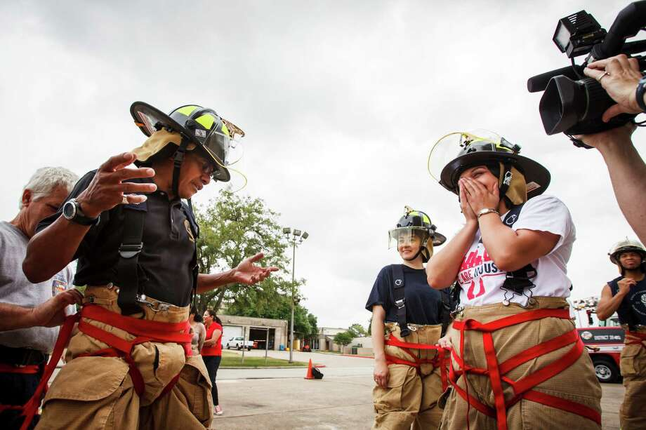 "William Paul Thomas, Houston City Council Liaison, (left to right), gets help with his harness as Helena Brown, Houston City Council Member, and Jessica Michan, Press Secretary, look on during a rappelling exercise with fellow Council Members and City Council staff at the one-day fire department orientation course called ""Fire Ops 101"" at the Houston Fire Department Val Jahnke Training Academy, Friday, April 27, 2012, in Houston. Photo: Michael Paulsen, Houston Chronicle / © 2012 Houston Chronicle"