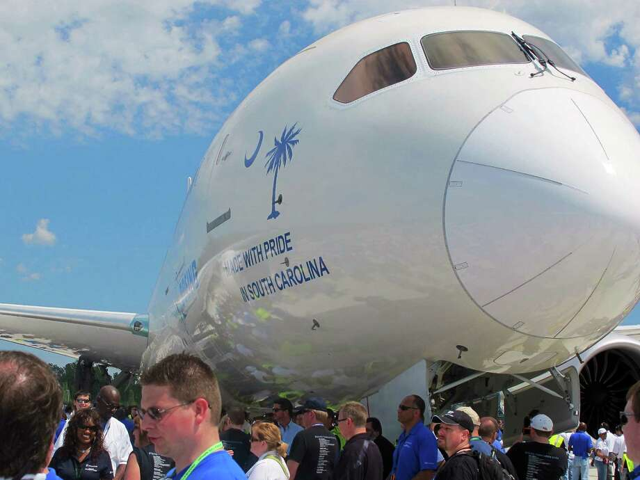 Boeing workers work gather around a 787 at the company's assembly plant in North Charleston, S.C., on Friday, April 27, 2012. The plane, rolled out Friday, is the first 787 manufactured at the company's South Carolina plant. Photo: AP