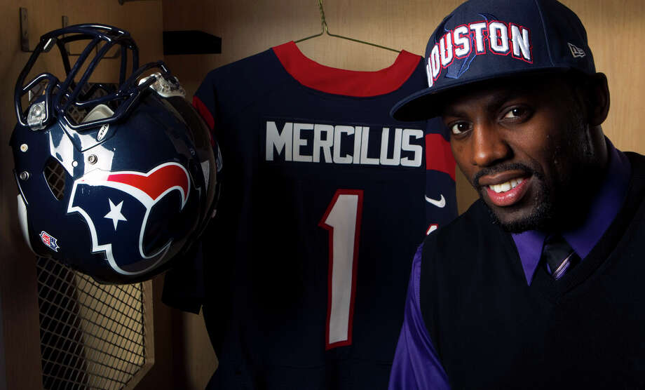 Take a look back at Whitney Mercilus' first few days as a Houston Texans player back in 2012....Houston Texans first-round draft pick Whitney Merciless poses in the Texans' locker room  Friday. Photo: Brett Coomer / © 2010 Houston Chronicle