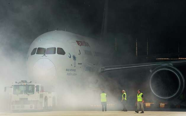 A new Boeing 787 Dreamliner built for Air India is rolled out of the hangar with a smoke machine and fireworks presentation April 27, 2012, at Boeing's new production facility in North Charlston, South Carolina.  The ceremony marks Boeing's first South Carolina made 787 Dreamliner aircraft.        AFP PHOTO / Paul J. Richards        (Photo credit should read PAUL J. RICHARDS/AFP/GettyImages) Photo: PAUL J. RICHARDS, AFP/Getty Images / 2012 AFP