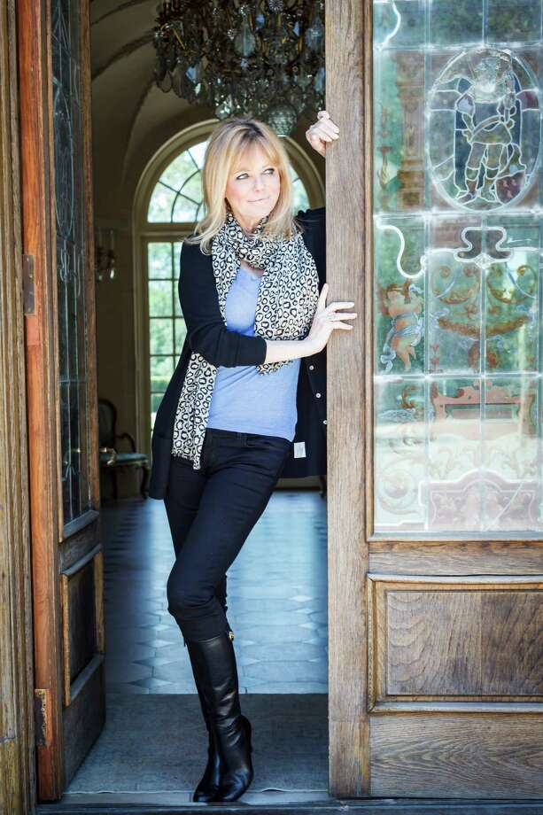 Cheryl Tiegs poses for a photo at the home of Terri and John Havens before attending the I Am Waters charity event to help Houston's Homeless, Tuesday, April 24, 2012, in Houston.  ( Michael Paulsen / Houston Chronicle ) Photo: Michael Paulsen / © 2012 Houston Chronicle