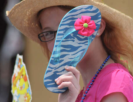 """Battle of Flowers Association essay contest winner Julia Wool of St. George Episcopal School """"shows her shoes"""" during the Battle of Flowers Parade on April 27, 2012. Photo: BILLY CALZADA, Billy Calzada / Express-News / San Antonio Express-News"""
