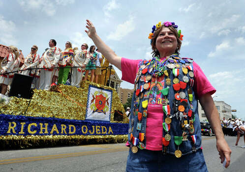 C.J. Jaramillo waves enthusiastically as the Rey Feo float passes during the Battle of Flowers Parade onApril 27, 2012. Photo: BILLY CALZADA, Billy Calzada / Express-News / San Antonio Express-News