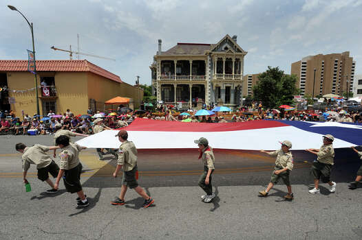 Members of the Alamo Chapter of the Boy Scouts of America carry a Texas flag during the Battle of Flowers Parade on April 27, 2012. Photo: BILLY CALZADA, Billy Calzada / Express-News / San Antonio Express-News